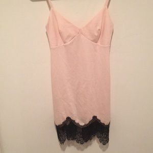 Form fitting NastyGal pink dress with lace details